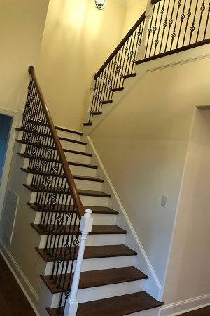 Home entryway steps with decorative iron spindles.