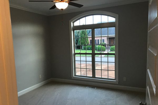 Large window in extra bedroom or home office.