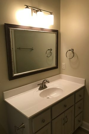 Guest bath with single sink vanity.