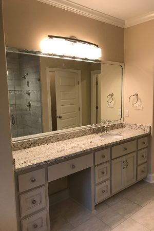 Master Bathroom with single sink vanity and make up counter.