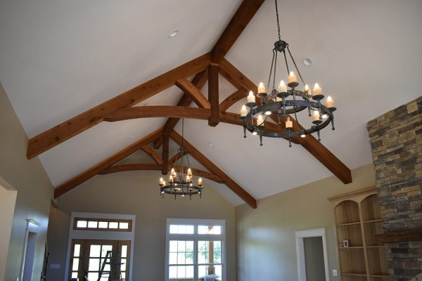 Vaulted living room ceiling with flameless candle light fixtures.