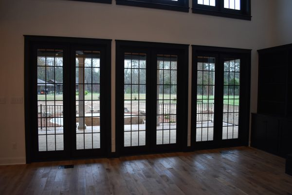 Wall of back porch doors in living room.
