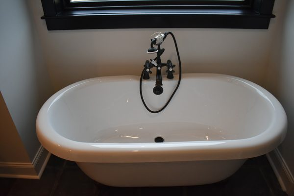 Luxurious white porcelain soaking tub.