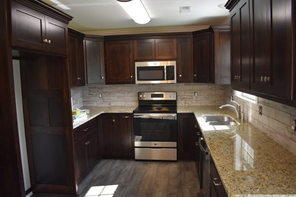Small galley kitchen with stainless steel appliances.