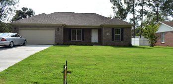 Grey brick house exterior.