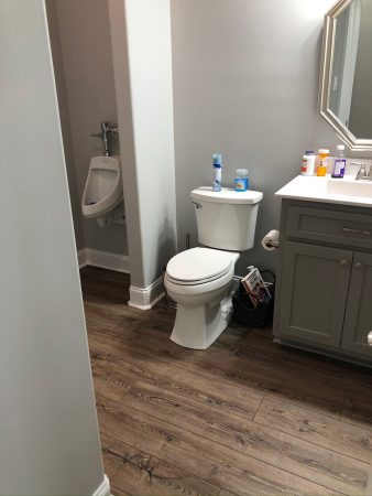 Bathroom with a toilet and a urinal.