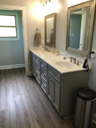 Master bathroom with double sink and marble countertop.